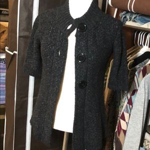 Black cardigan with large buttons.